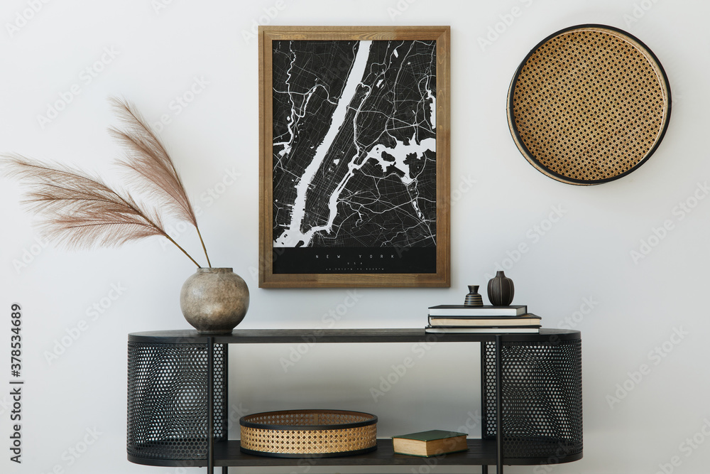 Fototapeta Modern scandinavian home interior with design wooden commode, mock up poster map, feather in vase, book and personal accessories in stylish home decor. Template.
