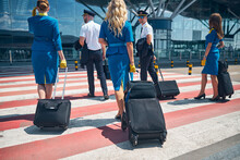 Aircrew With Travel Bags Cross...