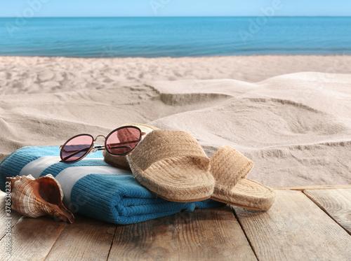 Fototapeta Beach accessories on wooden surface near sea obraz