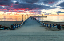 Colorful Sunset On Walking Marine Pier At The Baltic Sea Tourist Resort,  Europe