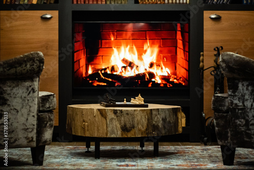 Chess Board and Pieces with Fireplace in Background Canvas Print