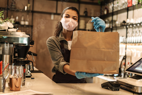 Fototapety, obrazy: Happy woman barista wearing medical mask