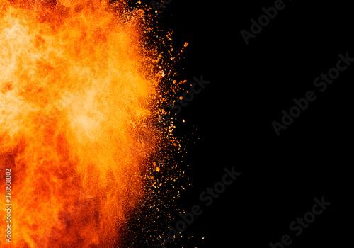 Valokuva Abstract orange powder explosion
