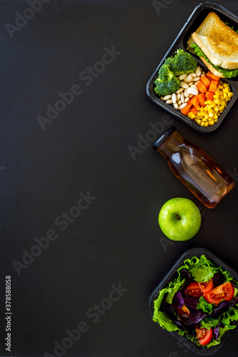 Delivery containers with takeout food on table. View from above