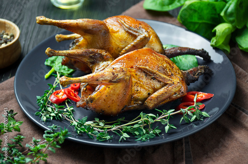 Baked quail with vegetables on a plate Wallpaper Mural