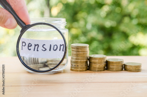 Photo Glass jar with coins and the word Pension