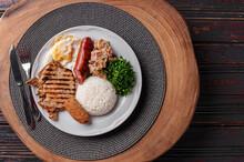 .Typical Dish Of Brazilian Cuisine Called Virado A Paulista. Top View. Copy Space