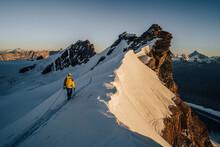 An Alpinist Climbing A Rocky A...