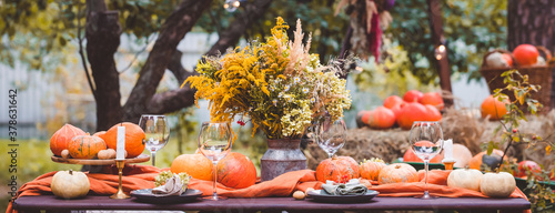 Fototapeta Fall themed holiday table setting arrangement for a seasonal party, banner obraz