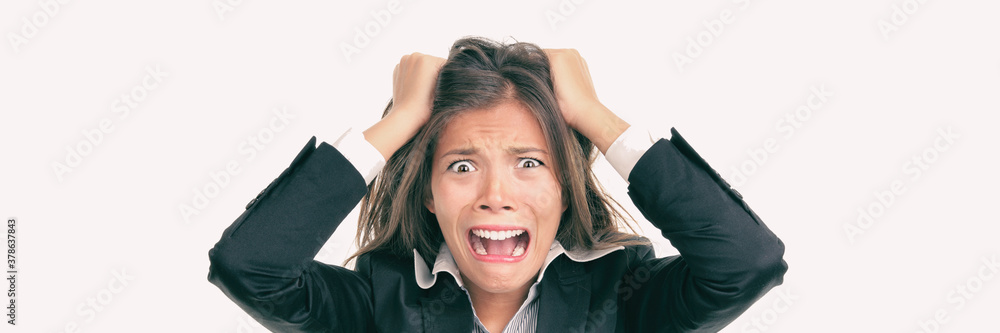 Fototapeta Funny crazy Asian business woman screaming in panic over stress at work. Mental health, anxiety, stressed out concept panoramic.