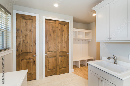 Fotografía Farm House Laundry Room with closets and built in  Shelving