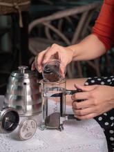 Putting Ground Coffee Into French Press Mug