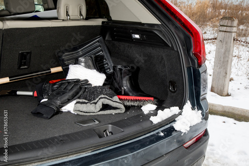 winter emergency automobile kit, hat, gloves, scarf, boots in the trunk Fototapet