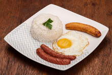 Typical Brazilian Dish, Diced Meat, Rice, Fried Egg And Fried Banana