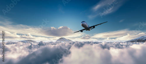 Airplane is flying above clouds at sunset Fototapete
