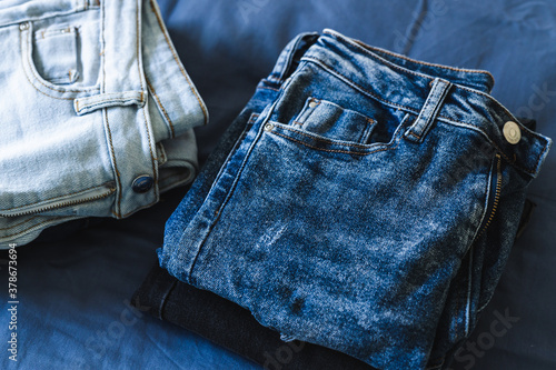 Cuadros en Lienzo organizing your wardrobe, different jeans in various denim colors getting sorted