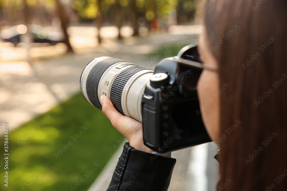 Fototapeta Private detective with camera spying outdoors, closeup