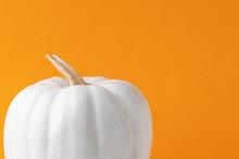 Halloween Background Of Pumpkin Painted White In Orange Background