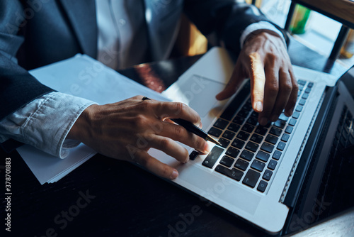 Fototapeta Laptop on the table businesswoman with a pen of technology communication official obraz