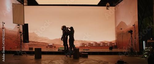 Obraz na plátně Behind the scenes shot of virtual production stage with huge LED screens, cinematorgapher shooting Mars scene