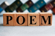 Poem Writing On Wooden Cubes And Books On The Background