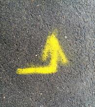 Yellow Arrow On The Asphalt, P...