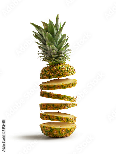 Fresh pineapple cut into slices flying, isolated from the white background Canvas Print