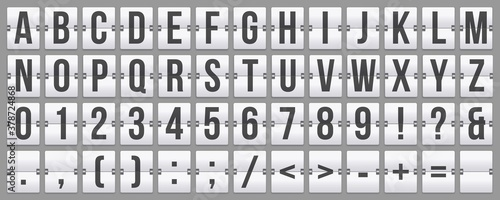 Fototapeta Mechanical scoreboard flip font with alphabet lettering, numbers and punctuation marks