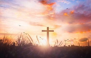 Religious concept: Silhouette cross and birds flying on sunrise background