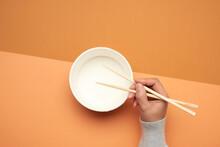 Pair Of Wooden Chopsticks In A...