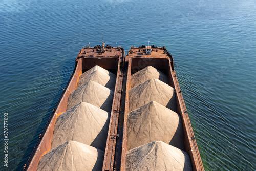 Billede på lærred Large sand barge - close-up, top view