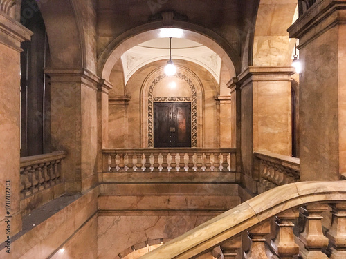Impressive marble staircase or stairwell in historic public building with railin Wallpaper Mural