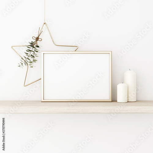 Fototapeta Horizontal frame mockup with gold matal star, eucalyptus, pine cones and candles on empty white wall background. Minimalist Christmas interior decoration. A4, A3 format. 3d rendering, illustration obraz