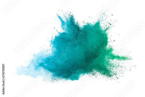 Obraz na plátně Explosion of colored powder isolated on white background.