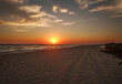 canvas print picture Beautiful sunset in sky, sandy beach on the sea coast
