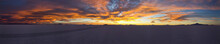 Large Natural Panorama Of Salar De Uyuni Salt Marsh In Bolivia At Sunset. Amazing Colorful View Of Setting Sun Late In Evening In Good Weather. Concept Of Travel. Copyright Space For The Site