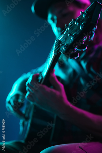 Close up of guitarist hand playing guitar, macro Fototapeta