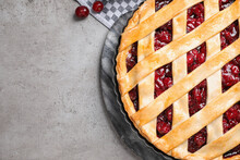 Delicious Fresh Pie And Cherries On Grey Table, Flat Lay. Space For Text