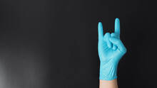 Hand Is Wear Blue Glove And Do...