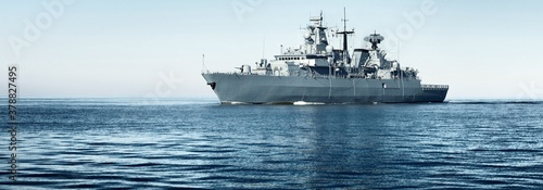 Cuadros en Lienzo Large grey modern warship sailing in still water