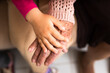 close up detail of female hands multigenerational family over each other. commitment, aging, care, support, unity concept.