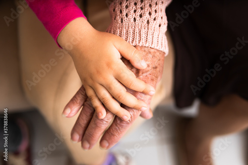 Obraz close up detail of female hands multigenerational family over each other. commitment, aging, care, support, unity concept. - fototapety do salonu