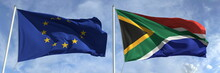 Waving Flags Of The European Union And South Africa On Flagpoles, 3d Rendering