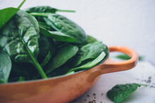 Spinach In A Orange Bowl
