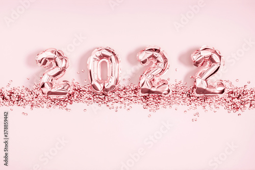 Fototapeta Happy New Year 2022. Foil balloons in form of numbers 2022. New year celebration. Pink Air Balloons on pink background. Flat lay, top view, copy space obraz