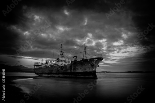 The ship in the shallows, a black-and-white photo Wallpaper Mural