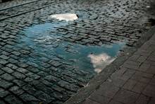 Rainwater On The Cobble Streets