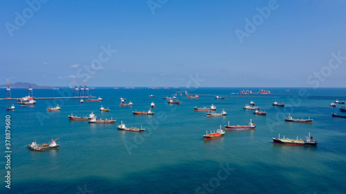 Fototapeta oil and gas tanker offshore in open sea, Refinery industry cargo ship, Oil product tanker and LPG tanker at sea view from above, Aerial view oil tanker ship with blue sky background. obraz