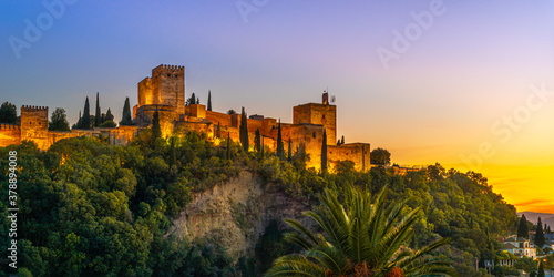 Granada, Spain. October 17th, 2020. View at sunset from below of the buildings and towers of the Alhambra illuminated by artificial lights.