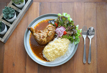 Chicken Curry. Top View Of Chicken Curry With Rice And Scrambled Egg Topping, On Wooden Table. Local Thai Called It Massaman Curry Chicken And Other Countries May Called It Muslim Curry.